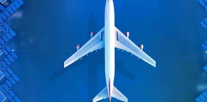 plane-in-solar-module-field-shutterstock-large-944x350